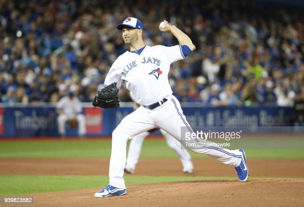 A Happ of the Toronto Blue Jays delivers the first pitch in the first inning on Opening Day during MLB game action against the New York Yankees at...