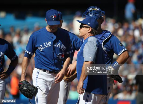 A Happ of the Toronto Blue Jays exits the game as he is relieved by manager John Gibbons in the third inning during MLB game action against the New...