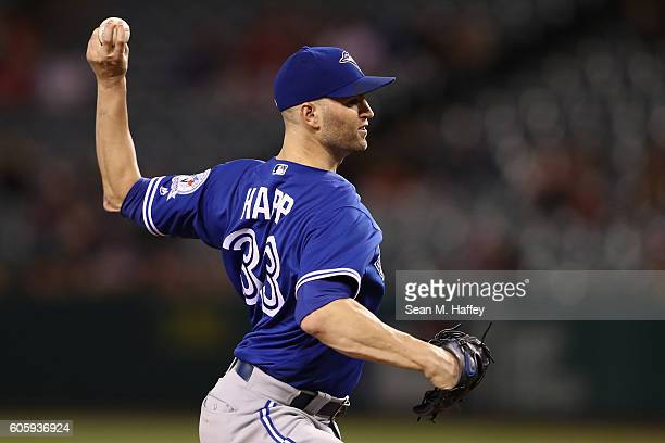 A Happ of the Toronto Blue Jays pitches during the first inning of a game against the Los Angeles Angels of Anaheim at Angel Stadium of Anaheim on...