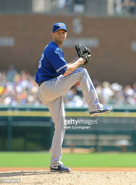 A Happ of the Toronto Blue Jays pitches during the game against the Detroit Tigers at Comerica Park on August 23 2012 in Detroit Michigan The Tigers...