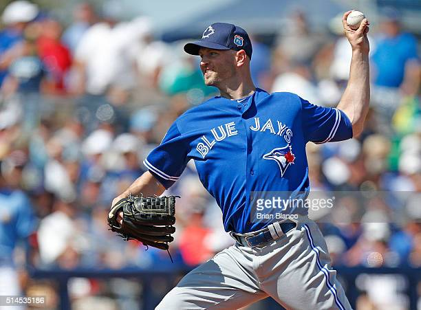 A Happ of the Toronto Blue Jays pitches during the third inning of an MLB spring training game against the Tampa Bay Rays on March 9 2016 at...