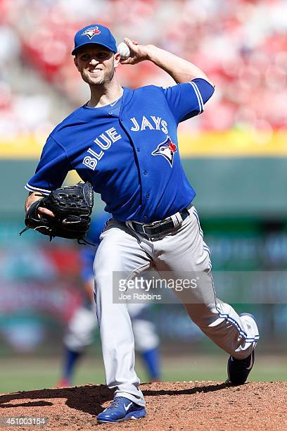 A Happ of the Toronto Blue Jays pitches in the second inning of the game against the Cincinnati Reds at Great American Ball Park on June 21 2014 in...