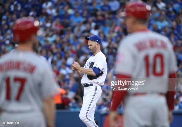 A Happ of the Toronto Blue Jays reacts after failing to get a favorable call on a pitch in the second inning during MLB game action against the Los...