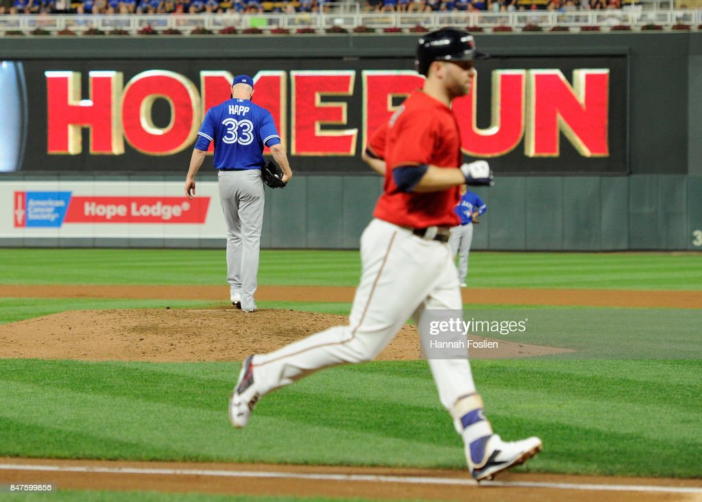 J.A. Happ #33 of the Toronto Blue Jays reacts as Brian Dozier #2 of the Minnesota Twins rounds the bases after hitting a solo home run during the fifth inning of the game on September 15, 2017 at Target Field in Minneapolis, Minnesota.