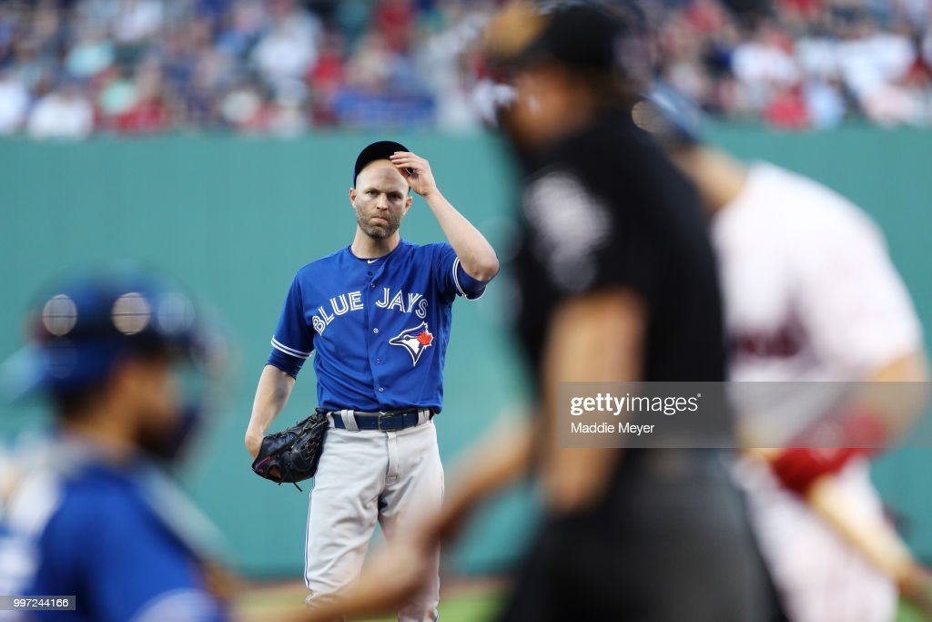 J.A. Happ #33 of the Toronto Blue Jays reacts during the first inning against the Boston Red Sox at Fenway Park on July 12, 2018 in Boston, Massachusetts.