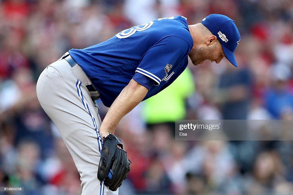J.A. Happ #33 of the Toronto Blue Jays reacts in the fifth inning against the Cleveland Indians during game two of the American League Championship Series at Progressive Field on October 15, 2016 in Cleveland, Ohio.
