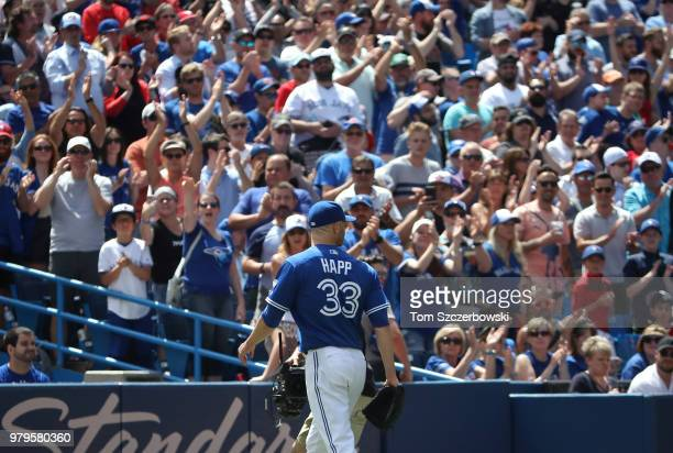 A Happ of the Toronto Blue Jays receives an ovation from the crowd as he exits the game after being relieved in the ninth inning against the Atlanta...