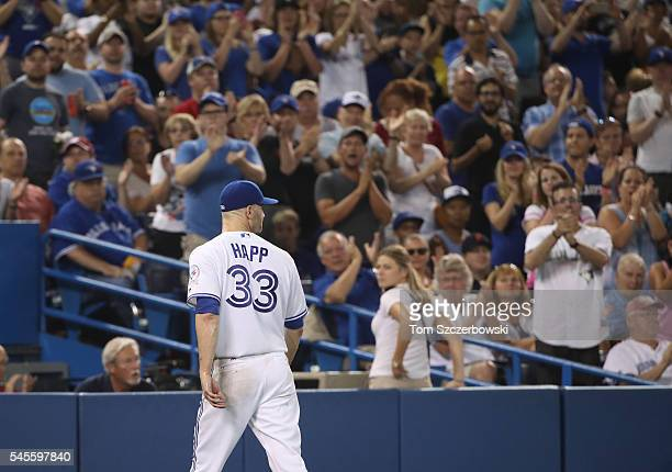 A Happ of the Toronto Blue Jays receives applause from fans as he exits the game without surrendering a run in the sixth inning during MLB game...