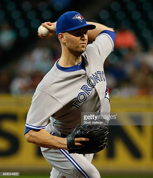 A Happ of the Toronto Blue Jays throws a pitch against the Houston Astros during the first inning of their game at Minute Maid Park on August 1 2014...