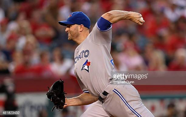 A Happ of the Toronto Blue Jays throws a pitch against the Los Angeles Angels of Anaheim at Angel Stadium of Anaheim on July 7 2014 in Anaheim...