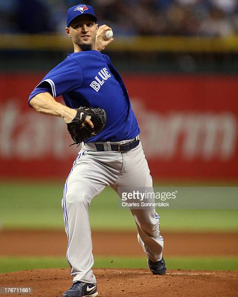 A Happ of the Toronto Blue Jays throws a pitch in the first inning against the Tampa Bay Rays during the game on August 17 2013 at Tropicana Field in...