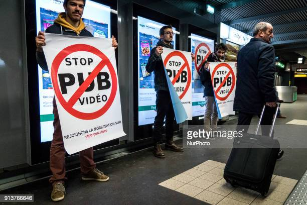 Happening against digital screen advertising in the subway of Lyon France on February 3 2018 About twenty people gathered in front of the bright...