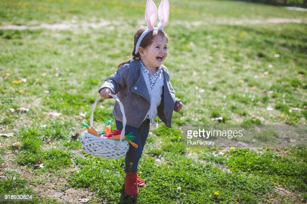 happiest during holidays - easter egg hunt stock photos and pictures