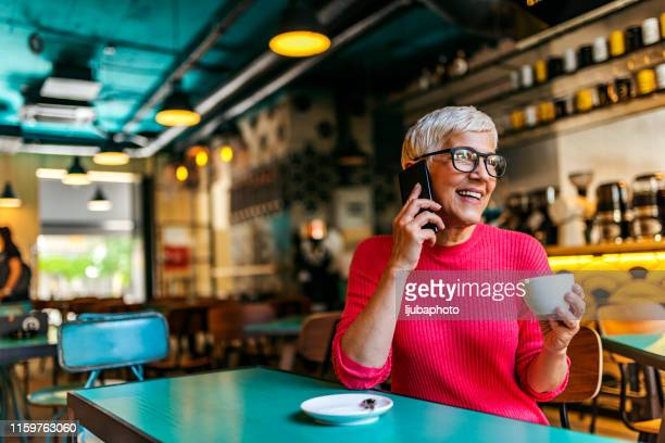 happiest when she's connected - white hair stock pictures, royalty-free photos & images