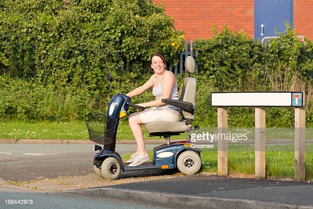 happily mobile. - mobility scooter stock photos and pictures