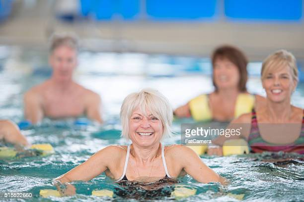 Happily Taking a Water Aerobics Class