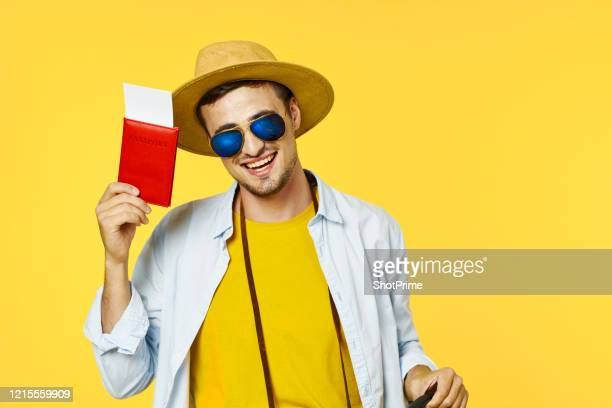 happily the traveler bought a plane ticket. - emigration and immigration stock pictures, royalty-free photos & images