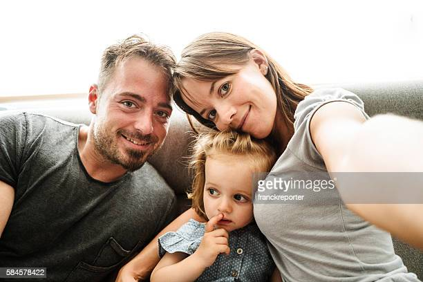 happiness british family on the living room take a selfie