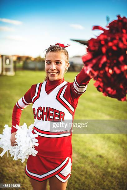 happiness cheerleader posing with pon-pon - teen cheerleader stock photos and pictures