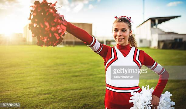 happiness cheerleader posing with pon-pon - cheerleaders stock photos and pictures