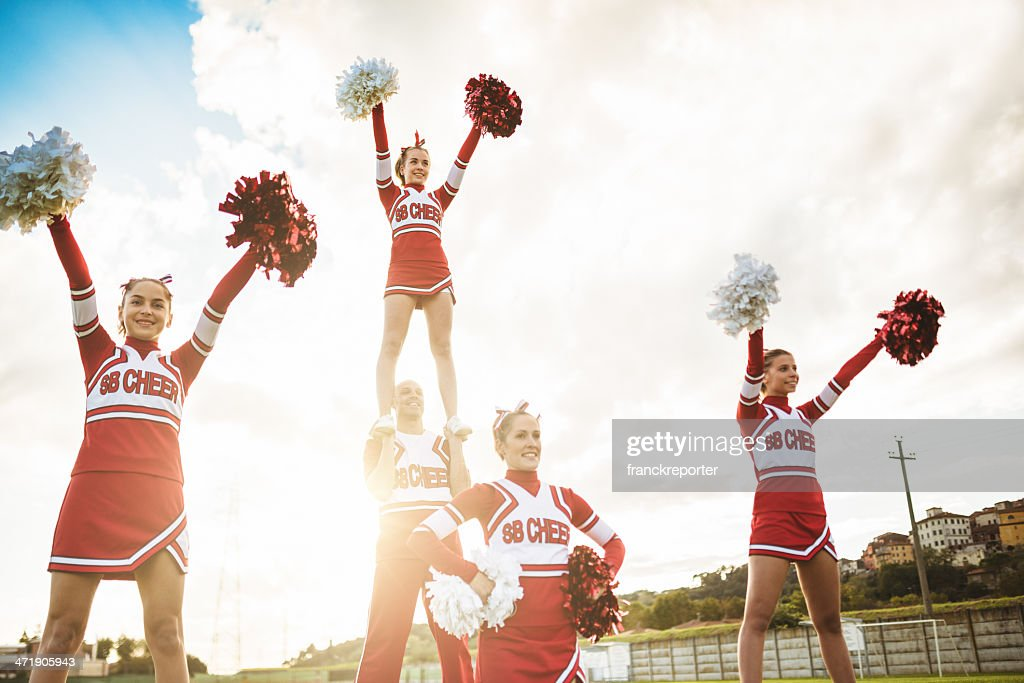 Happiness cheerleaders posing with pon-pon : Stock Photo