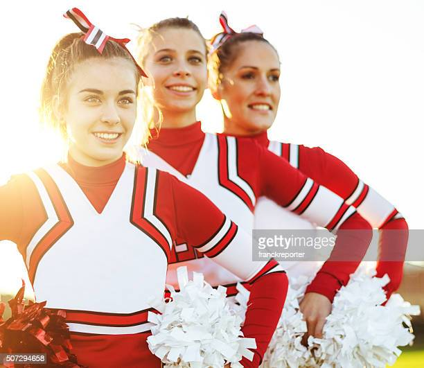 happiness cheerleaders posing with pon-pon - sports uniform stock pictures, royalty-free photos & images
