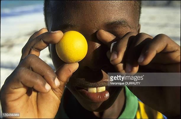Happiness Child with lemon in Jambiani beach in Zanzibar Tanzania
