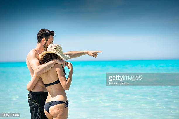 happiness couple at the seaside - beautiful polynesian women stock photos and pictures