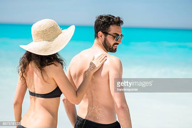 happiness couple at the seaside relaxing - shirtless stock pictures, royalty-free photos & images