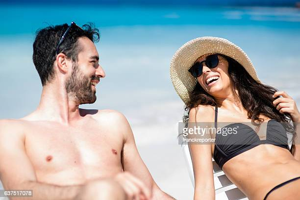 Happiness couple at the seaside relaxing