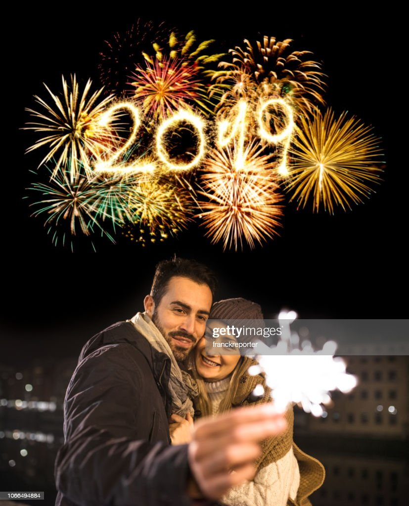 happiness couple celebrate the new year with spark : Stock Photo