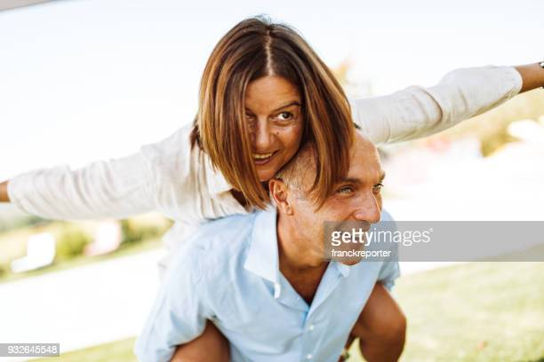 happiness couple piggyback