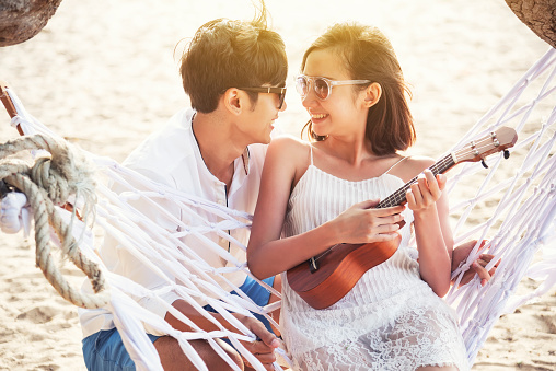Happiness couple playing ukulele in summer times. - gettyimageskorea