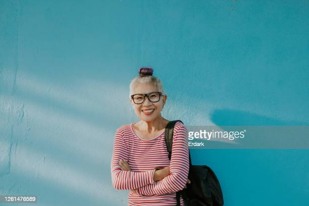 happiness face of senior hipster thai woman - showus stock pictures, royalty-free photos & images