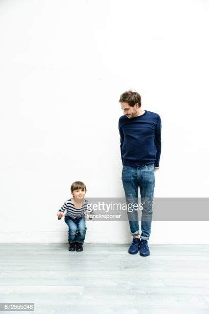 happiness family on white wall