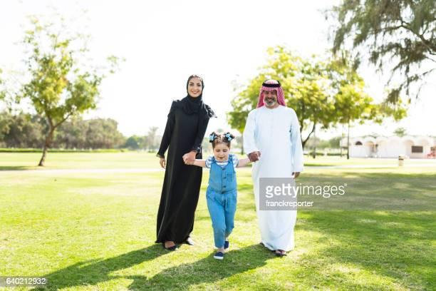 happiness family walking in the park in saudi arabia