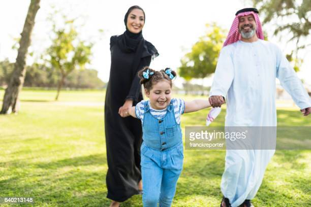 happiness family walking in the park in saudi arabia