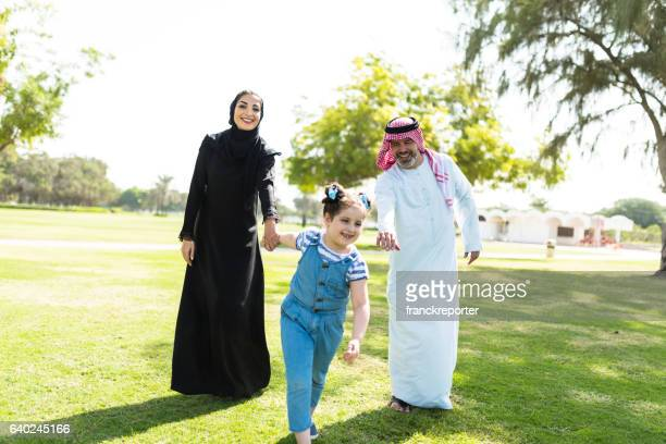happiness family walking in the park in saudi arabia - saudi stock pictures, royalty-free photos & images