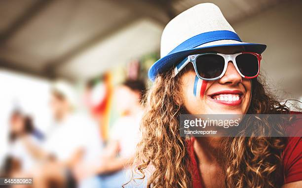 happiness french supporter woman at the stadium - fan enthusiast stock pictures, royalty-free photos & images