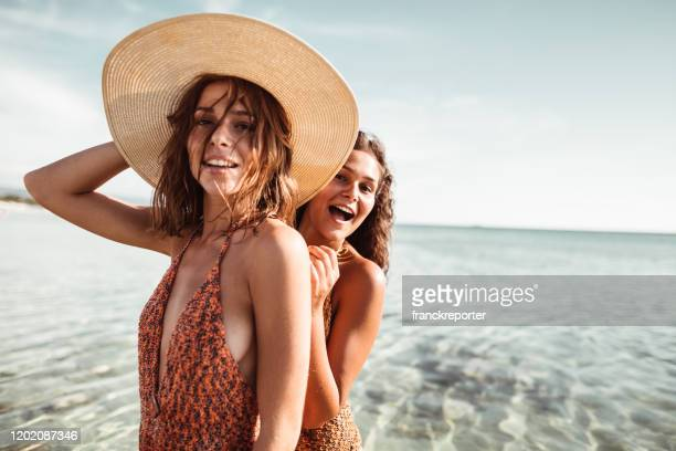 happiness friends at the seaside with panama hat - beautiful beach babes stock pictures, royalty-free photos & images