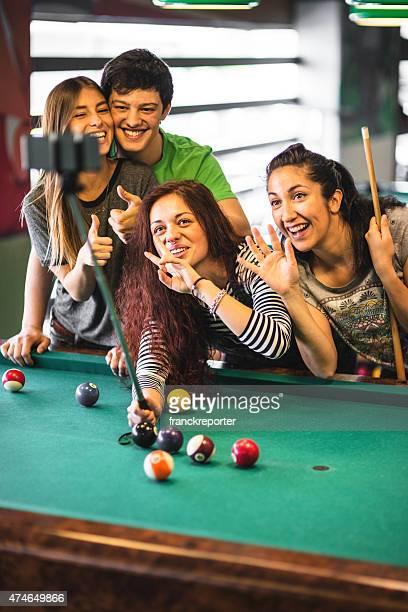 Happiness friends in a pub take a selfie