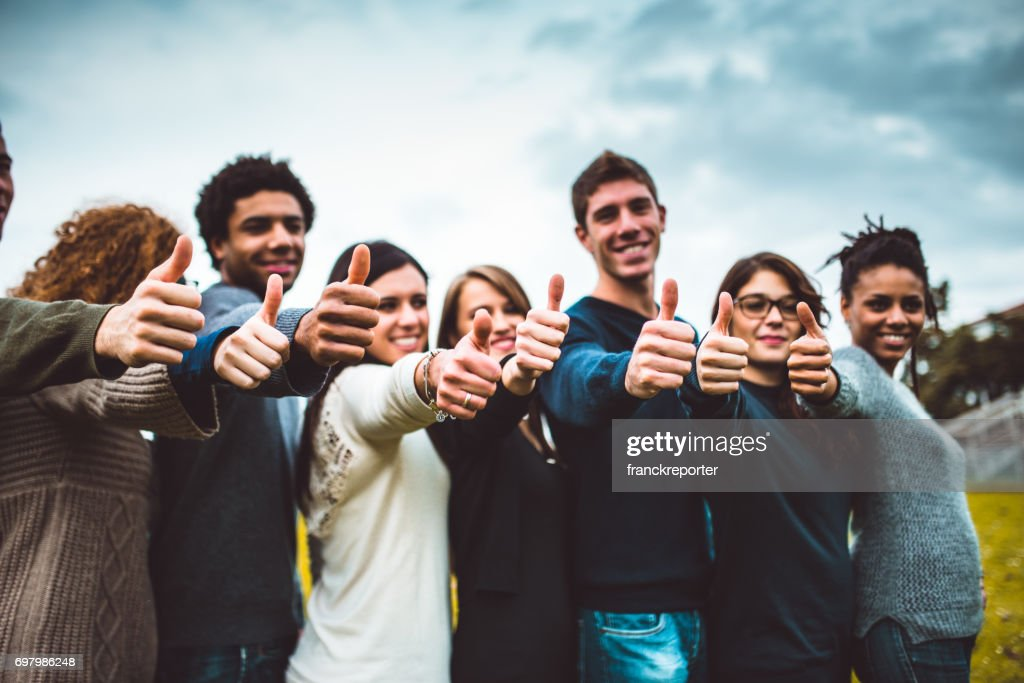 happiness friends thumbs up for victory : Stock Photo