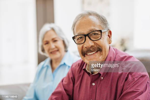 happiness in golden age - latino seniors living joyful life after year 65. - 70 79 years stock pictures, royalty-free photos & images