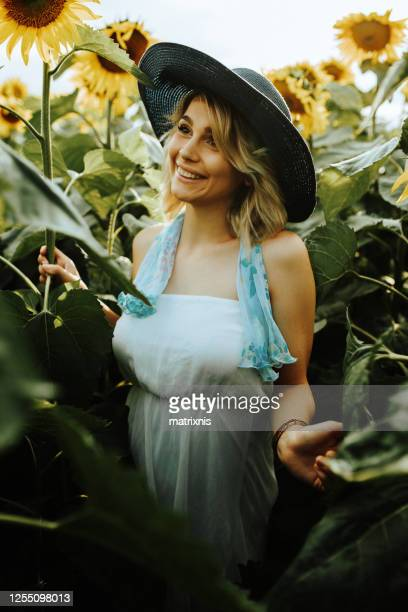 happiness in the sunflower field - matrixnis stock pictures, royalty-free photos & images