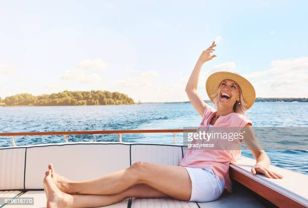 happiness inspired by a boat ride - only mature women stock pictures, royalty-free photos & images