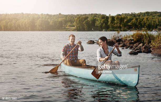 happiness inspired by a canoe ride - kayak stock pictures, royalty-free photos & images