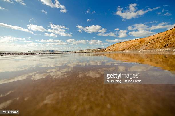 happiness is a big wet beach all to yourself - isle of wight stock photos and pictures