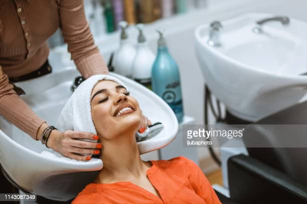 happiness is a day at the salon - hair treatment stock pictures, royalty-free photos & images