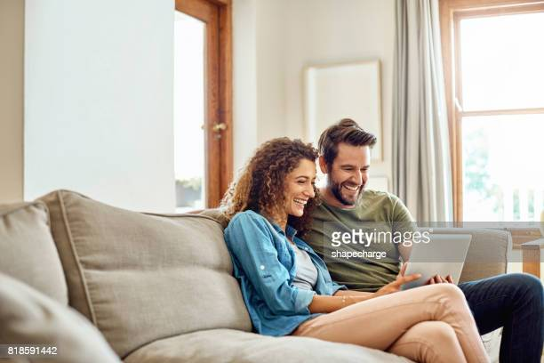happiness is being connected to the home wifi - young couple stock pictures, royalty-free photos & images