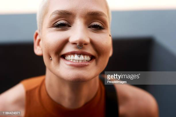 happiness is written all over her face - nose piercing stock pictures, royalty-free photos & images